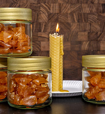 Various products like boiled sweets and candles are sold in local markets. Photo: Photo Langeland